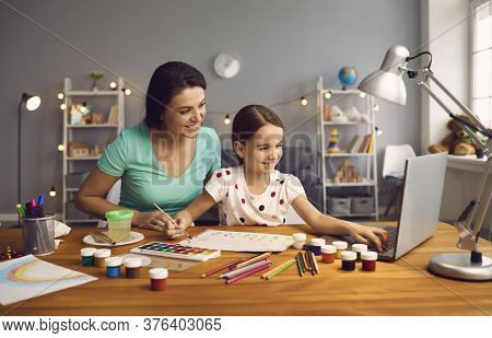 Online Education Of Children. Mother And Daughter Of Preschool Watching A Video Lesson Call Chat Cre