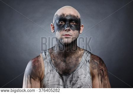 Picture Of Young Bald Mad Man With Dirty Make-up Effect