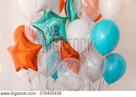 Composition Of Blue, Silver, Orange And Transparent Balloons With Helium. Foil Balloon In The Shape