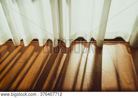 Curtain Decorated Beautifully In The Room, Bright Morning Sun In The Window Through The Curtains, Wh
