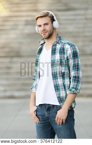 Audio Only For Your Ears. Handsome Guy Wear Audio Headphones. Young Man Listen To Music Outdoors. Li