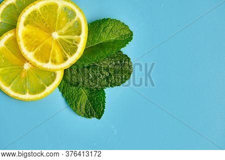Composition With Cut Citrus Fruits On Blue Background. Creative Summer Background Composition With L
