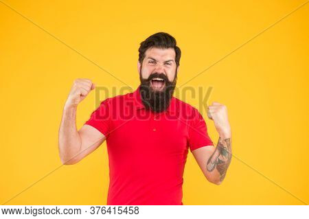 Inner Energy. Motivated For Success. Happy Man Show Success Gesture Yellow Background. Victory And S