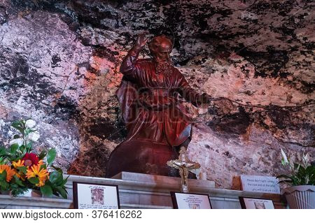 Haifa, Israel, July 10, 2020 : The Small Statue Of St. Elijah Made Of Red Marble Stands On The Altar