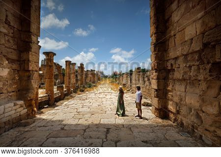 Active Couple with Pleasure Visiting Ruins of Tyre. Enjoying Majestic Ancient Architecture. Spending Romantic Vacation in Lebanon.