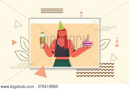 Woman In Festive Hat Celebrating Online Birthday Party Girl In Computer Window Holding Cocktail And