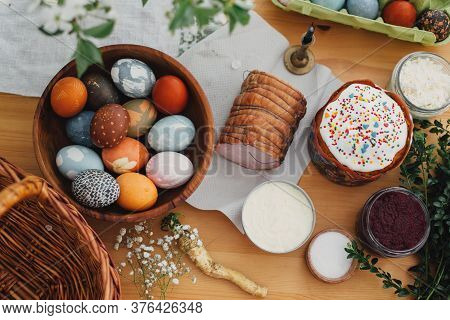 Easter Food Flat Lay. Easter Eggs Natural Dyed, Easter Bread, Ham, Beets, Butter, Green Branches  An