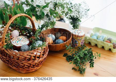 Easter Modern Eggs, Easter Bread, Ham, Beets, Butter, In Wicker Basket Decorated With Green Buxus Br