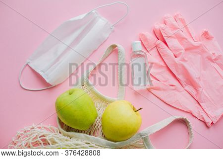 Safe Shopping In Quarantine. Pink Gloves, Face Mask, Disinfection Bottle And Tote Bag With Fresh App