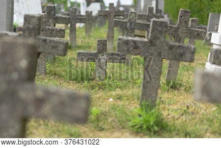 Sint Gillis Waas, 09 Juli 2019, Concrete Weathered Crosses In An Old Graveyard