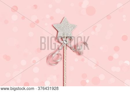Festive Bright Silver Star With Sequins On Soft Pink Background With Baubles Decoration. Minimal Hol