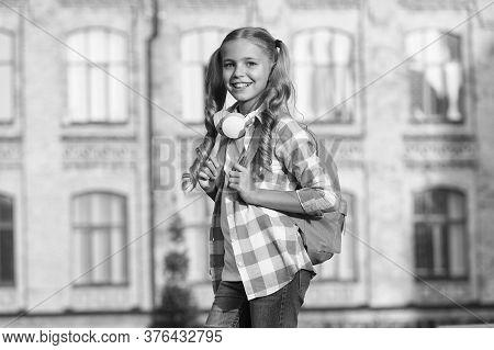 School Life. Student. Modern Education. Cheerful Teen Listening Music. Schoolgirl Going To School. S