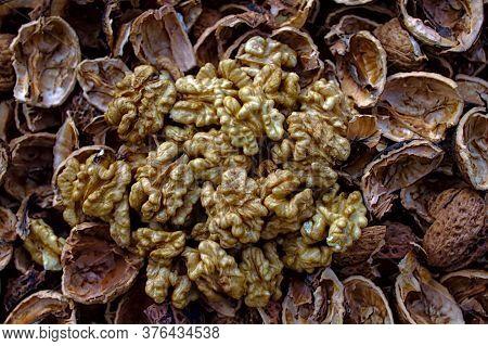 The Picture Shows Walnuts, Walnut Shells And Walnut Kernels