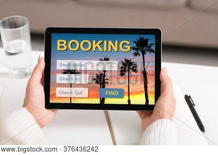 Businesswoman Using Digital Tablet Booking Hotel Planning Vacation Sitting In Office Indoors. Search