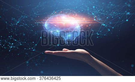 Artificial Intelligence Concept. Hand Holding Shining Brain Over Galaxy Background