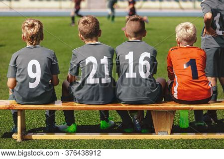 Boys In Football Team Sitting On Substitute Bench Ready To Play The Final Tournament Match. School K