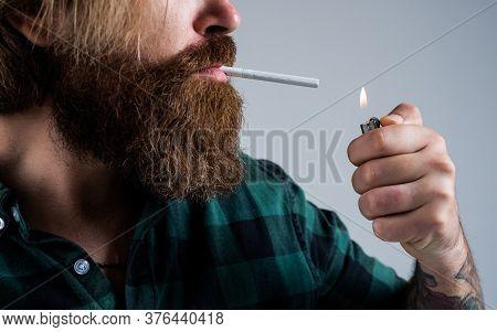 Lightng The Cigarette. Bearded Man. Smoking Cigarette Habit. Brutal Hipster With Moustache. Fashion