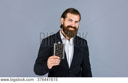 Really Good Taste. Flat Metal Bottle For Alcohol. Man With Elegant Look. Bearded Hipster In Suit Hol