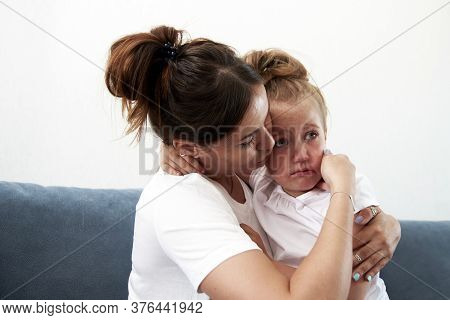 The Mother Pities Daughter.the Little Girl Is Sad. Mother Becalms Litlle Girl.