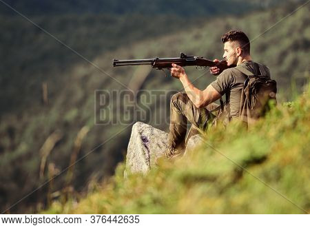 Soldier In The Field. Combat Readiness. Muscular Man Hold Weapon. Purpose And Success. Military Styl