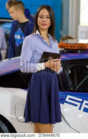 Belgrade / Serbia - March 23, 2019: Beautiful Hostess Girl At The Belgrade Car And Motor Show In Bel