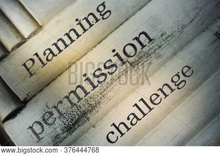 Distressed Newspaper Headline Reading Planning Permission Challenge