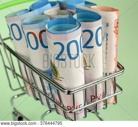 Russian Rubles In A Trolley On A Light   Background. Grocery Basket And Russian Rubles. Russian Curr