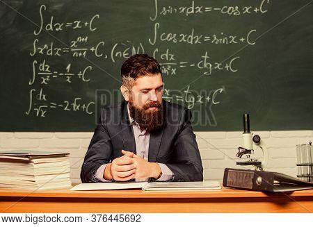 Hipster School. Hipster Teacher. Hipster In Class. Bearded Man In Formalwear At Teachers Table. Brut