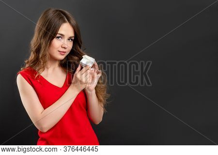 Holiday Gift. Ads Background. Woman In Red Showing Jewelry Box Isolated On Gray Empty Space.