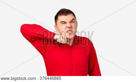 Furious Man Portrait. Violence Anger. Aggressive Guy In Red Shirt Threatening To Cut Throat Isolated