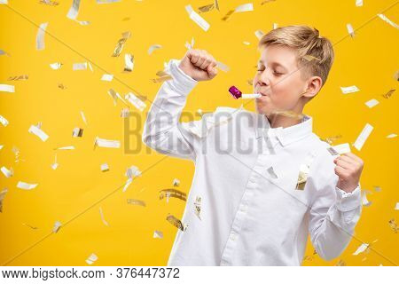 Birthday Boy Portrait. Festive Joy. Happy Kid Dancing With Party Horn In Confetti Rain Isolated On Y