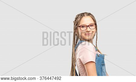 Kids Eyewear. Eyesight Correction. Happy Girl In Stylish Eyeglasses Smiling Isolated On Neutral Copy