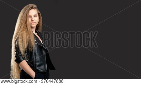Youth Lifestyle. Advertisement Background. Confident Teen Girl With Long Hair Standing Isolated Dark