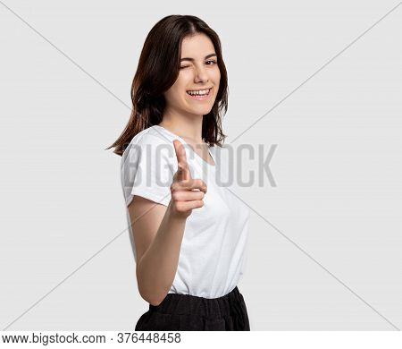 Encouraging Gesture. Admiration Support. Cheerful Woman Pointing Finger Winking Isolated On Neutral