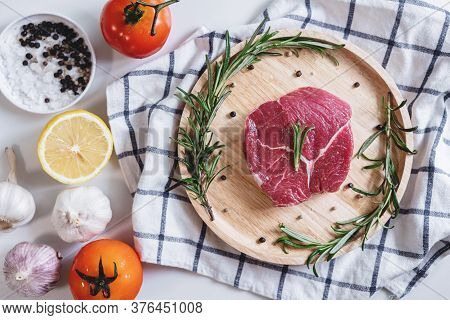 Raw Beef Steak Tenderloin Fillet, With Tomatoes, Rosemary And Lemon
