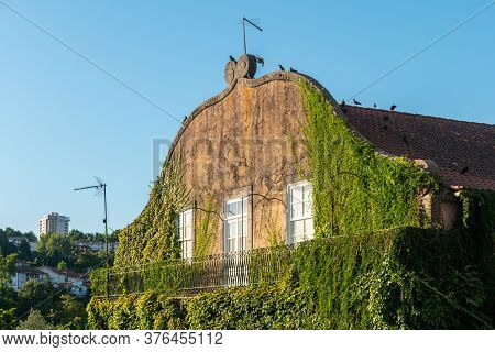 Amarante, Portugal - Circa July 2020: Old House With Green Facades For Natural Living. Amarante Has