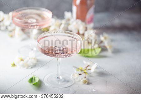 Homemade Pink Vodka Cosmopolitan Cocktail Drink In Crystal Glasses