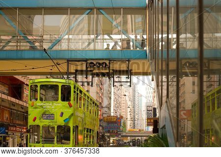 Wan Chai, Hong Kong Island, Hong Kong, China, Asia - December 05, 2008: Traditional Tram And Store S