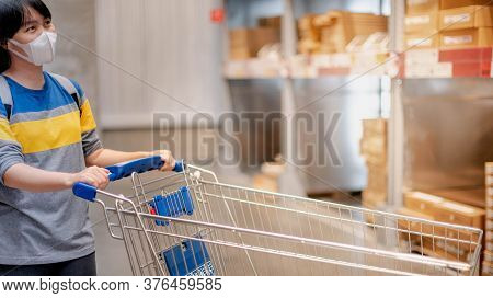 The Asian Girl Wearing Surgical Mask Pushing The Trolley Cart Shopping The Decorate Funiture For Int