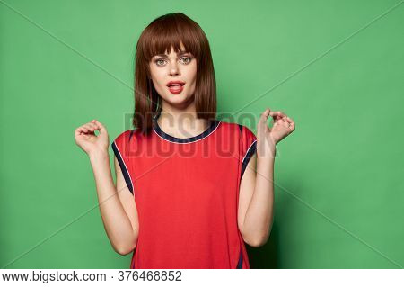 A Woman With A Surprised Look Looks At Te Camera