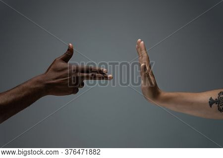 Stop Negative. Racial Tolerance. Respect Social Unity. African And Caucasian Hands Gesturing On Gray
