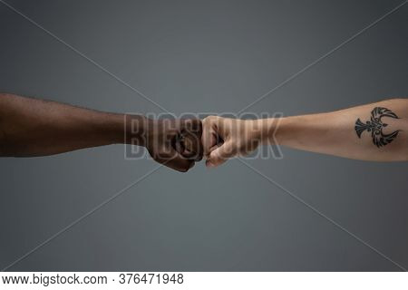 Greeting Fist Bump. Racial Tolerance. Respect Social Unity. African And Caucasian Hands Gesturing On