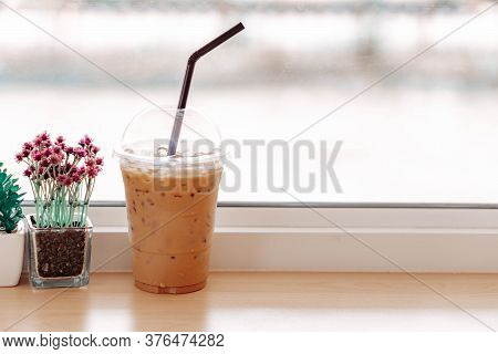 Close Up Glass Of Ice Americano Coffee On Wood Table, Selective Focus