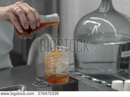 Barista Hand Holding Lab Borosilicate Glass Beaker Mixing Tea Drink Beverage In Chemistry Bar Beaker