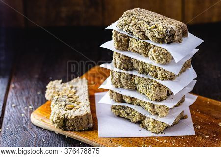 Sliced ​​vegan Cake, With Rolled Oats, Chia, Flaxseed And Chestnuts, Walnuts And Brazil Nuts. Health