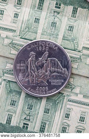 A Quarter Of California On Us Dollar Bills. Symmetric Composition Of Us Dollar Bills And A Quarter O