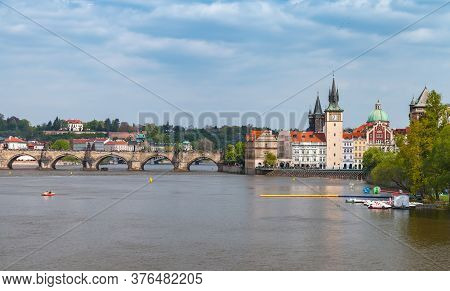 Old Prague View At Summer Day. Vltava River, Smetana Museum In The Former Waterworks And Water Tower