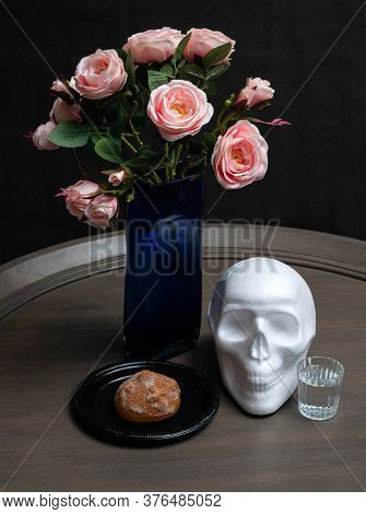 White Skull, Mexican Day Of The Dead Bread, Mezcal And Roses On Black Background