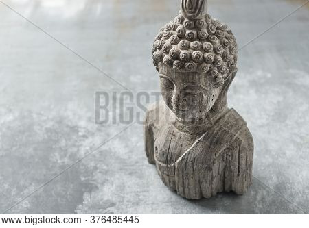 Meditating Buddha Statue On Rustic Wooden Background. Copy Space.