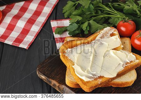 Simple Breakfast. Toasted Bread Covered With Butter